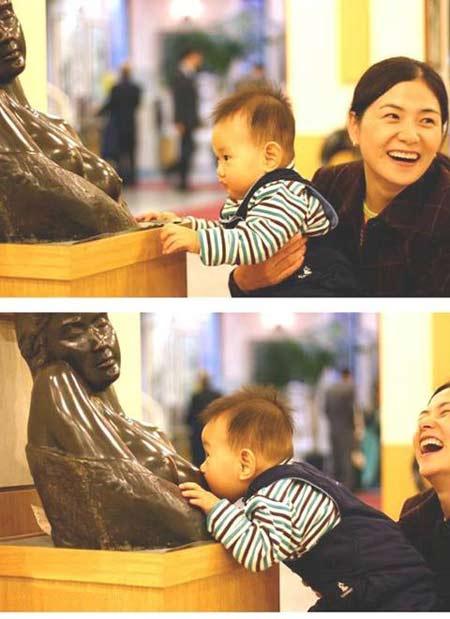 baby-sucking-statue